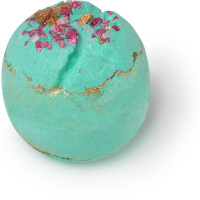 A teal coloured, spherical bath bomb with pink and gold bath salts on top.