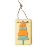 Rechteckiges, gelbes Ölbad mit einem orangefarbenen Tannenbaum als Dekoration