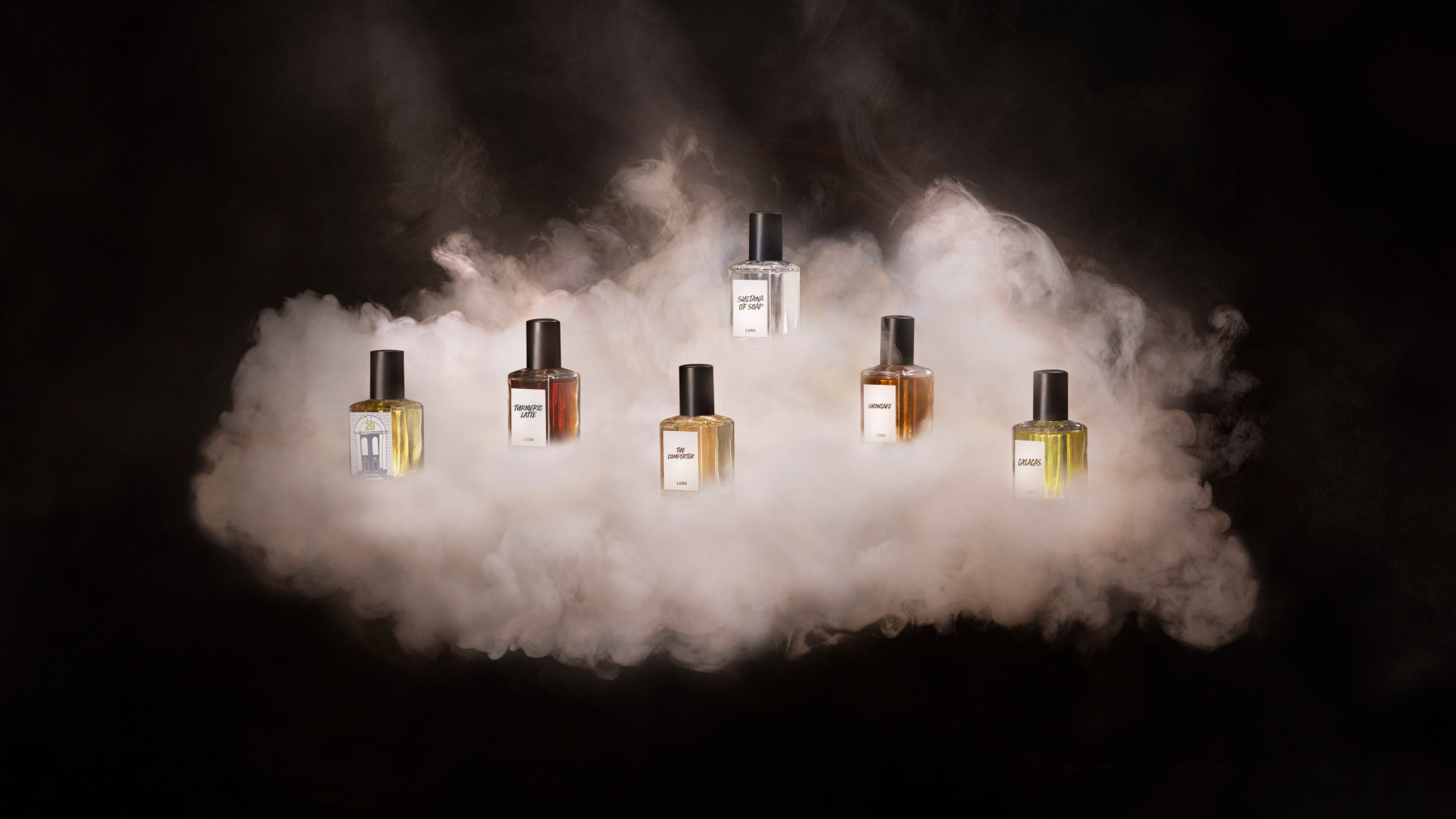 community perfumes in a cloud of smoke on black background