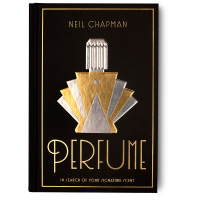 black book cover with golden perfume bottle image