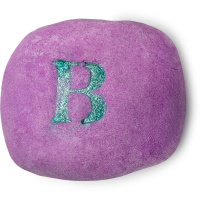 purple bubble bar with the letter b written in green glitter on top