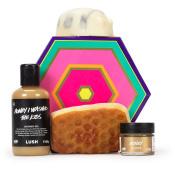 Caja de regalo Honey de diseño colorado con un jabón, un exfoliante labial, un gel de ducha y una barrita de masaje todos con miel