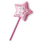 Pinkes, sternförmiges Schaumbad auf einem pinken Stäbchen