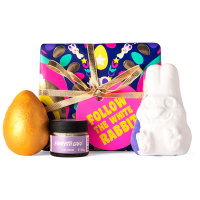 purple egg and rabbit themed gift box with products around it