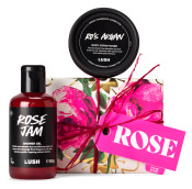 white and pink rose themed gift with products around it