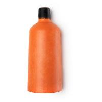 Eine feste, orange Duschcreme in der Form einer Flasche