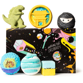 black space themed present with products surrounding it