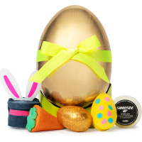 golden egg shaped box surrounded by products that come inside the gift