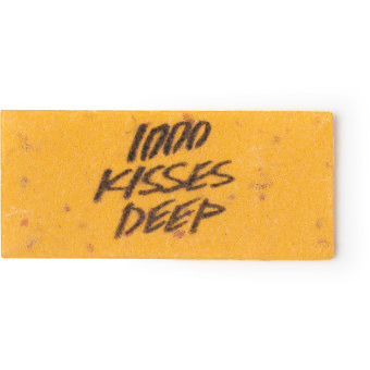 A golden yellow washcard featuring the words 1000 kisses deep