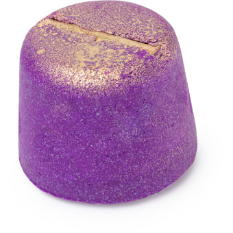 A purple bath bomb with golden glitter