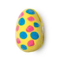 Bright yellow bubbleroon in the shape of a egg with blue and pink spots