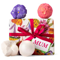 white floral themed gift box with products around it