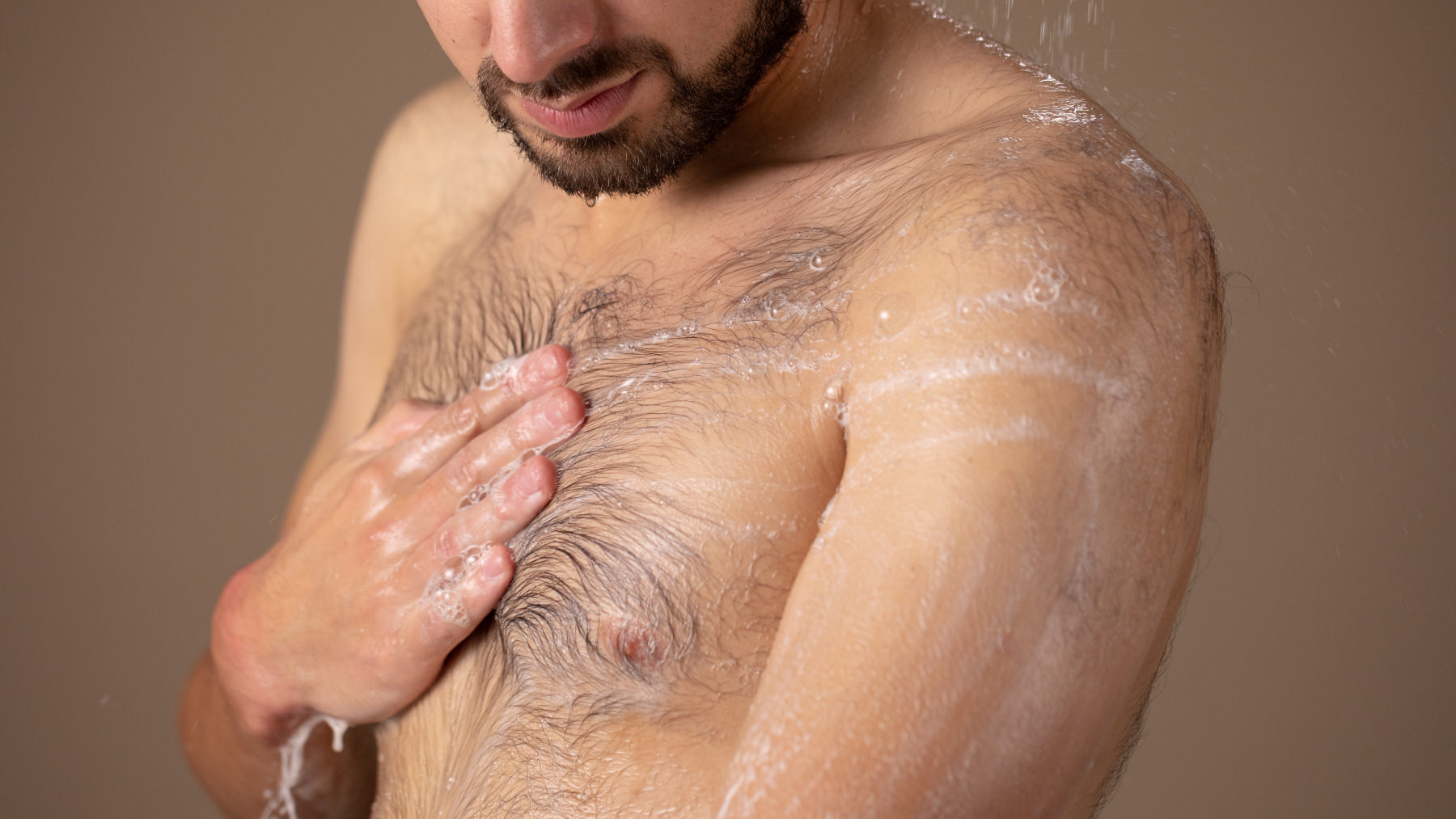 A person showering with the Sonic Death Monkey shower gel