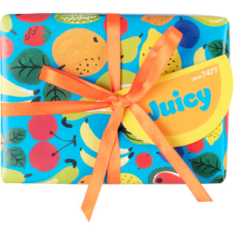 A blue gift box covered in a fruit pattern wrapped in a orange ribbon