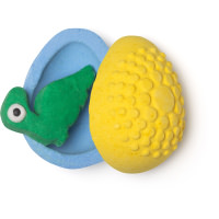 blue and yellow egg shaped bath bomb with green dinosaur shaped fun product inside
