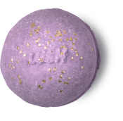 A pink purple bath bomb with a few little golden starts on it the Lush logo ingrained on it
