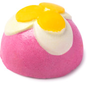 pink dome shaped body scrub with white and yellow flower on top