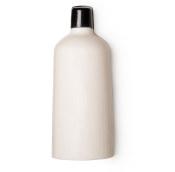 A white bottle shaped solid shower gel