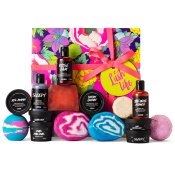 multicoloured floral themed gift box with products around it