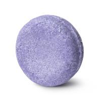 A round, purple shampoo bar