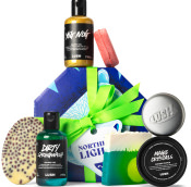 dark blue polar bear themed gift box with products around it