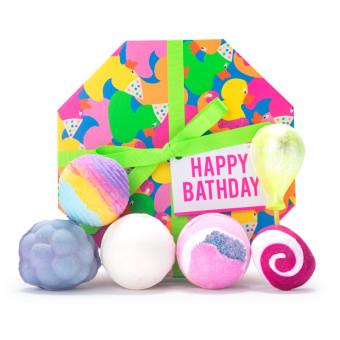 happy bathday gift with product surrounding gift