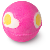pink bath bomb with fried eggs pattern on the sides