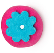 A round vibrant pink bubble bar with a royal blue flower on top