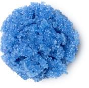 Um pedaço azul do esfoliante labial Unicorn
