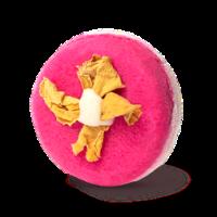 coconut rice cake champú sólido de color rosa y redondo con flores amarilla y con coco