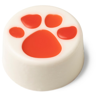 white circular soap with red paw print on top