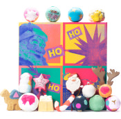 pop art style gift with pink and greyscale santa and a santa sleigh with lush products surrounding gift