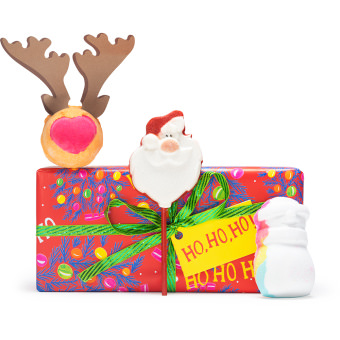 red gift box with green ribbon with a snowman bath bomb outside
