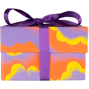 The lilac, yellow and orange Relax gift box as viewed from the side