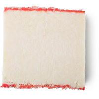 Weißes, festes Shampoo, rechteckig mit rosafarbener Wachsschicht an der Außenseite