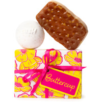 buttercup themed present with products around it