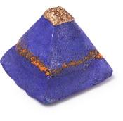 Spumante da bagno colorato a forma di piramide viola con punta dorata