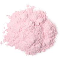polvos corporales de color rosa con purpurina