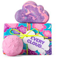 light blue gift box with purple clouds on it and products around it