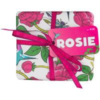Weißes Geschenk mit Rosen bedruckt und pinker Schleife