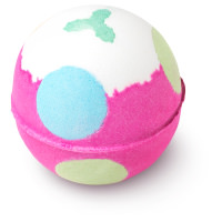 pink bath bomb with blue and green dots and a holly leaf shape on top