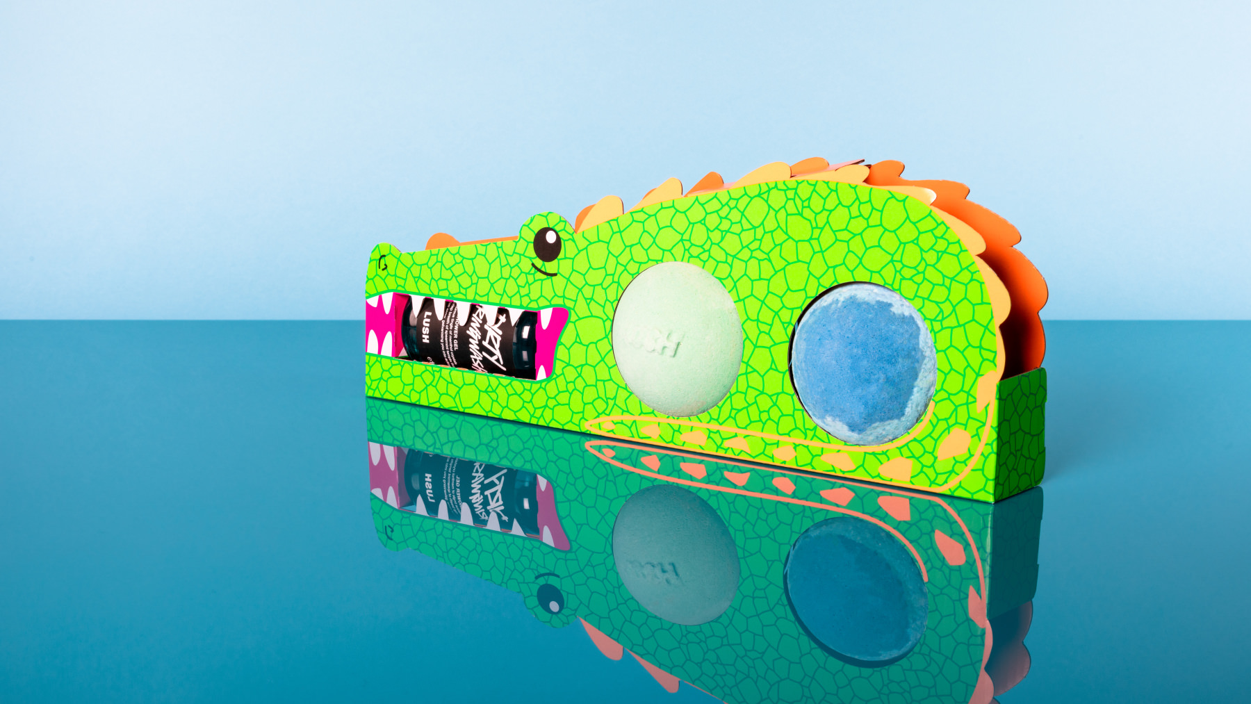 green crocodile themed gift with two bath bombs and a shower gel inside
