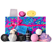 pink and blue floral themed gift box with products around it