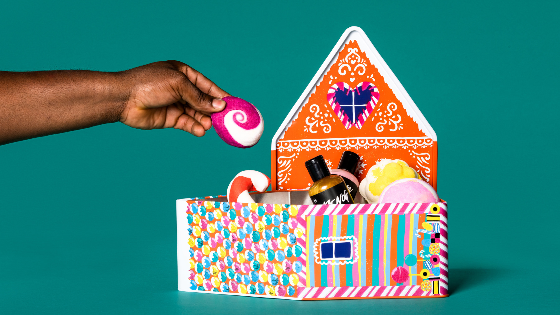 ginger and orange gift set in shape of a gingerbread house