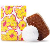 Buttercup gift on white background showing contents inside, Lush products Buterball Bath Bomb and Honey I Washed The Kids Soap