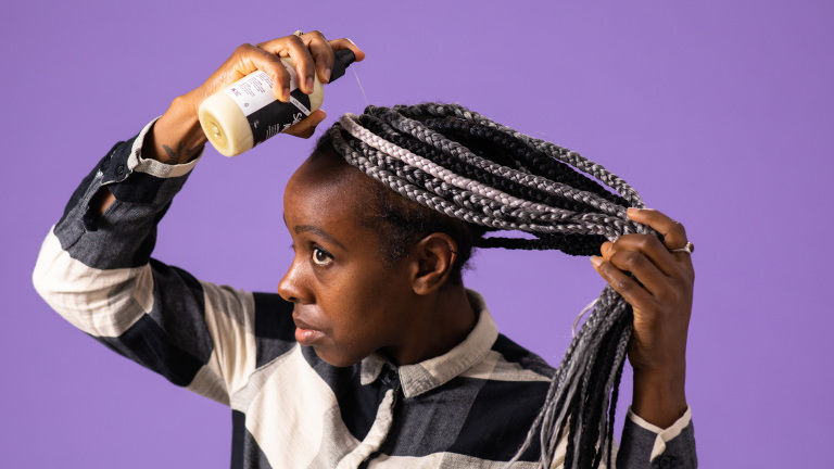 a spray on conditioner being used in hair