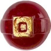 Rundes, rotes Duschgelly mit goldener Deko in Form einer Gürtelschnalle