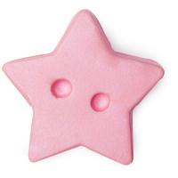 Ein Puderdöschen aus Körperbutter in Form von einem pinken Stern