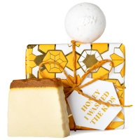 white and golden honey themed gift box with products around it