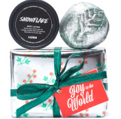 silver present with green and red pattern and green ribbons with soap and body lotion on top on white background